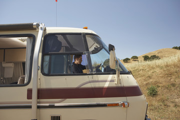Young man driving a recreational vehicle