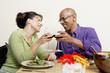 Couple toasting while eating salad