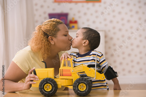 Profile of mother kissing son