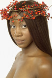 Young woman wearing crown of berries on her head