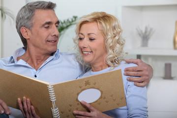 Couple looking through photo album