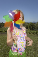 Young girl playing with a pinwheel