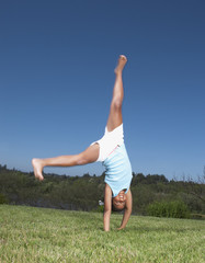 Young girl turning a cartwheel