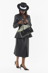 Businesswoman holding a purse full of money