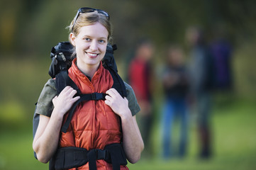 Young backpacker smiling for the camera outdoors