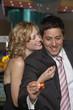 Woman hugging her boyfriend at a casino