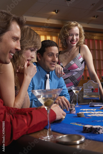 People playing at a blackjack table