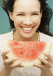 Young woman eating a seedless watermelon