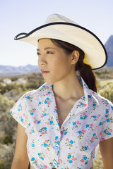 Young woman in cowboy hat posing for the camera