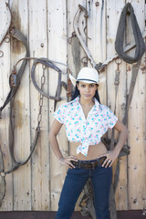Young woman in a cowboy outfit posing for the camera
