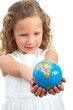 Young girl looking at earth sphere.