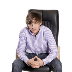 young, handsome man sitting on a chair