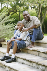 Father and son sitting on steps