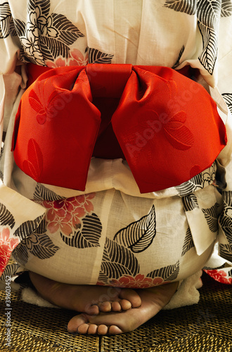 Midsection rear view of woman in kimono