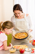 Apple pie mother and daughter baking