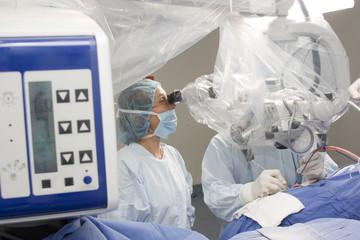Surgeon Using Operating Microscope