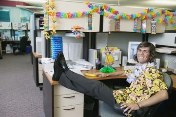 Full length businessman in Hawaiian decorated office