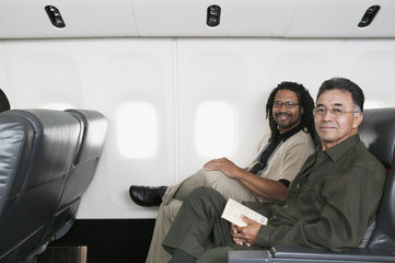 Portrait of two men on airplane