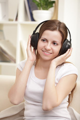 beauty girl listen music in headphones