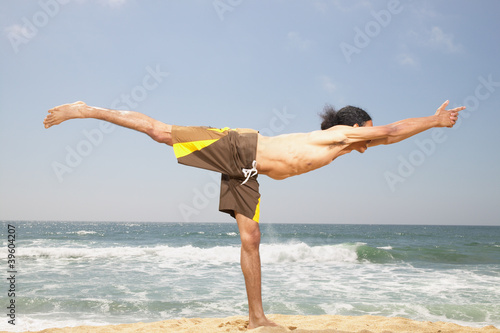 Man stretching at beach