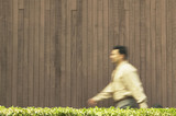 Blurred view of businessman walking