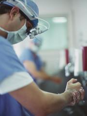 Male surgeon washing his hands