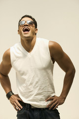 Young man in sunglasses laughing