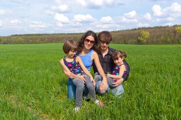 Happy family outdoors having fun on vacation