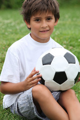 Little boy holding football