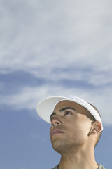 Close up of man wearing sun visor