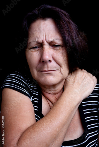 Senior lady suffering from shoulder pain