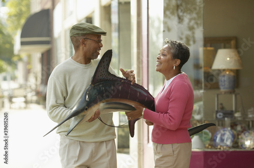 Couple buying mounted fish