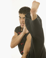 Portrait of man kick boxing