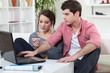 Young man and young woman making shopping online