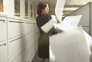 Businesswoman leaving paper trail
