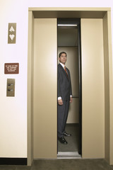 Businessman in elevator