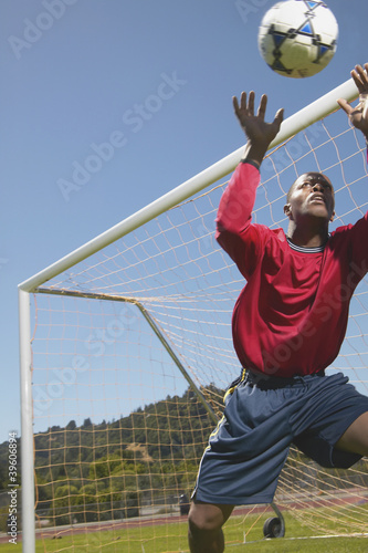 Goalie stopping ball in soccer game