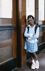 Portrait of girl standing in hallway at school