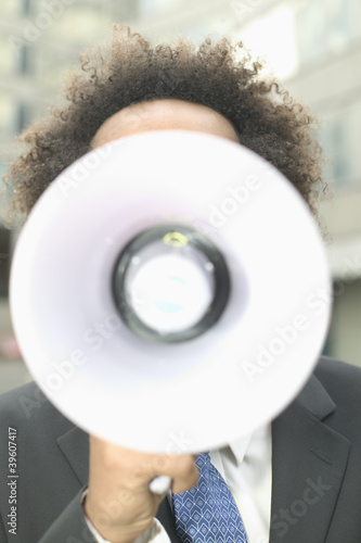 Businessman talking through megaphone