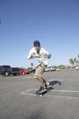 Portrait of man on skateboard