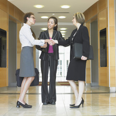Three businesswomen talking