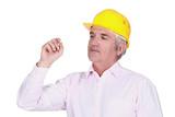 senior businessman wearing a helmet and looking at something