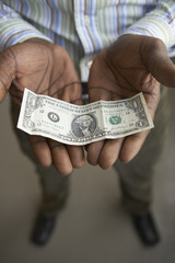 Close up of businessman holding dollar bill