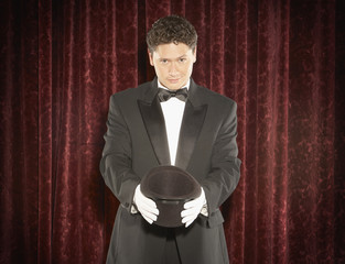 Magician holding an empty top hat