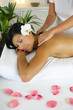 Woman having exotic back massage