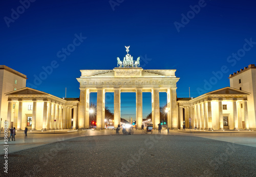 The illiminated Brandenburg Gate at dawn