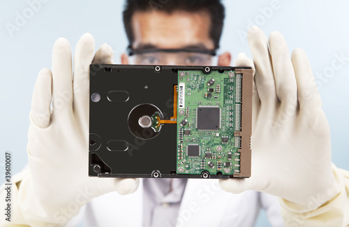 Scientist with computer harddisk