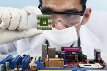 Scientist holding a Computer Microchip