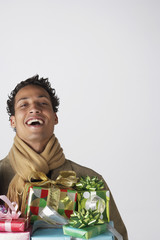 Young man holding gifts