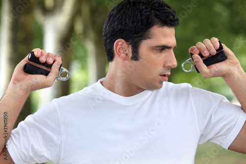 Man performing wrist exercise